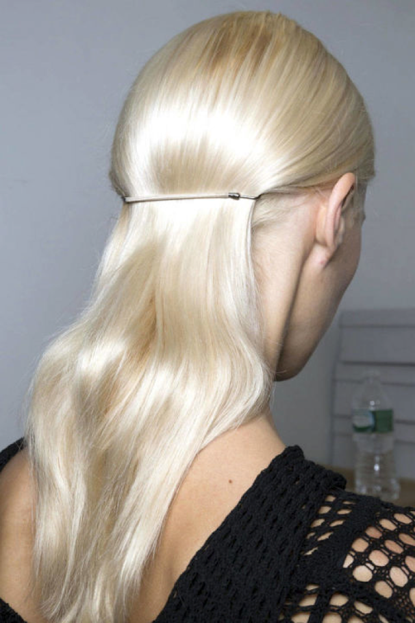 You can find these Hair Bungee's at any good hairdressing supply store, they are the essential hair tie!  Blow-dry your hair smooth, once dried take big sections and wind the hair around the barrel of a large curling tong to give the hair a slight bend. Tease the hair at the crown if you fancy a little height up top then smooth some serum through the hair for polish. Section the hair all the way around from ear to ear and gather that hair into a ponytail using two Bungee Bands hooked together, as close to the head as possible.  The trick to this look is smoothness to the top and sides and a looser ponytail with movement. Spray the finished look with some shine spray to seal the deal!