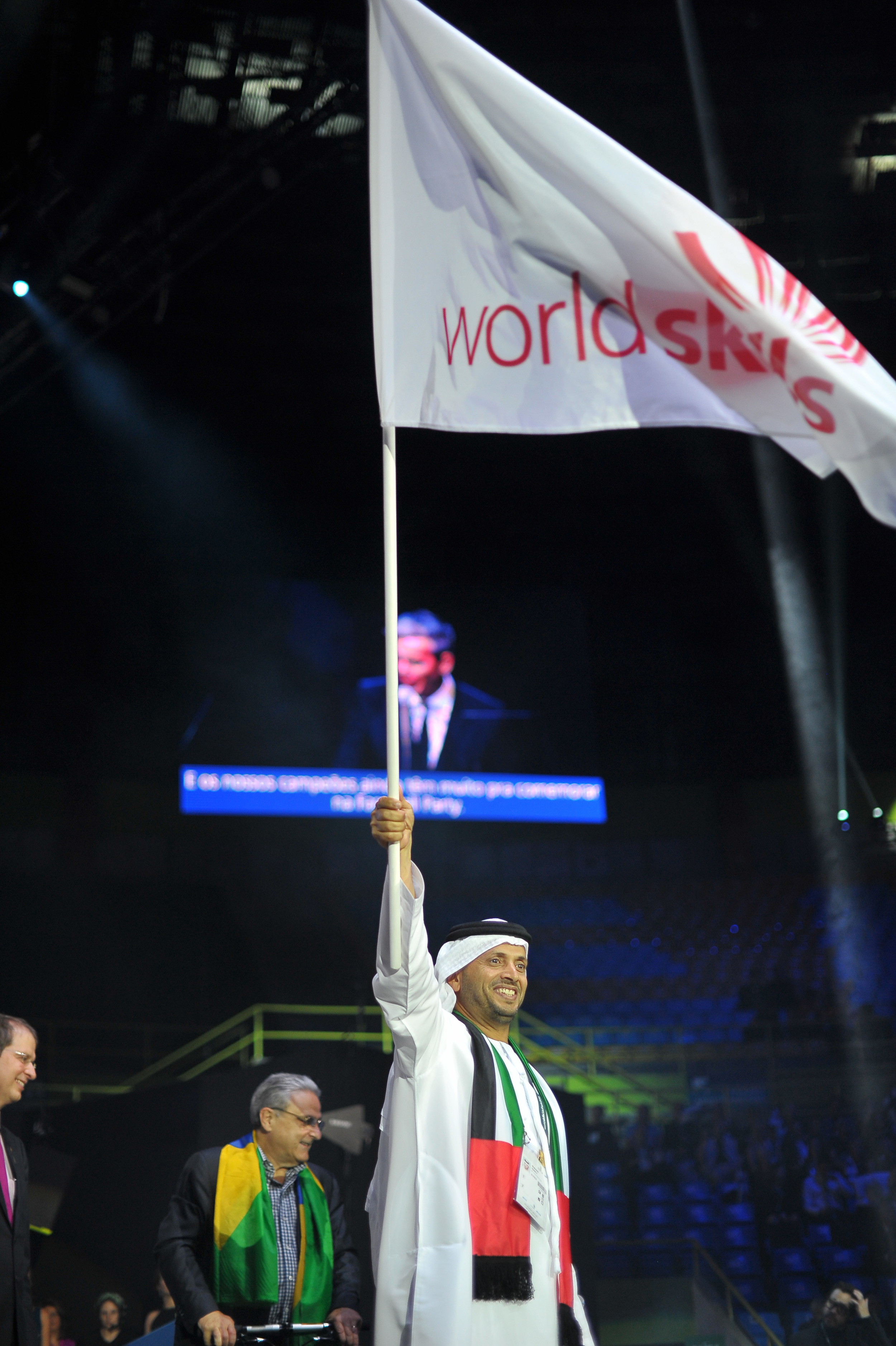 His Excellency Mubarak Saeed Al Shamsi with the WorldSkills flag (Photo credit: WorldSkills International)