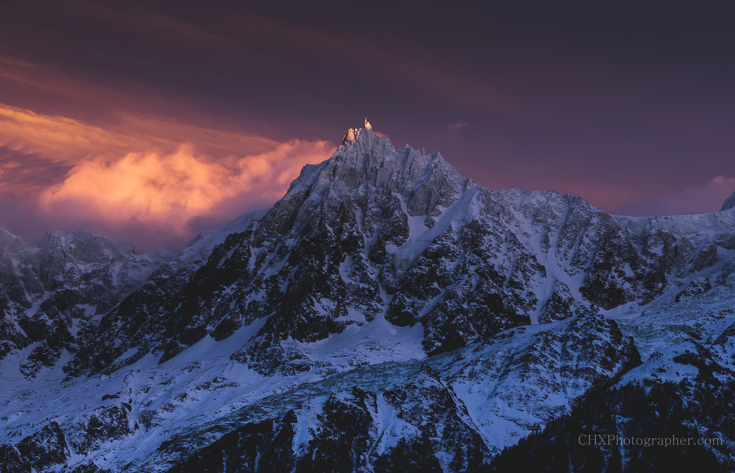 A fiery sunset over the Aiguille du midi in Chamonix, France