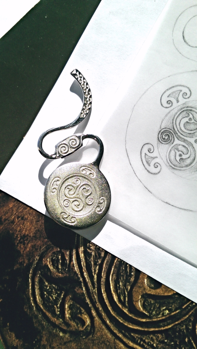 Bronze Dress Fastener: The La Tene period, 600 AD, was a time of great richness of expression in Irish Art. My brooch is based on this unusually shaped Bronze Dress Fastener of the period, with carved detail. (NMI, W.492 Archaeology) Source - National Museum of Ireland