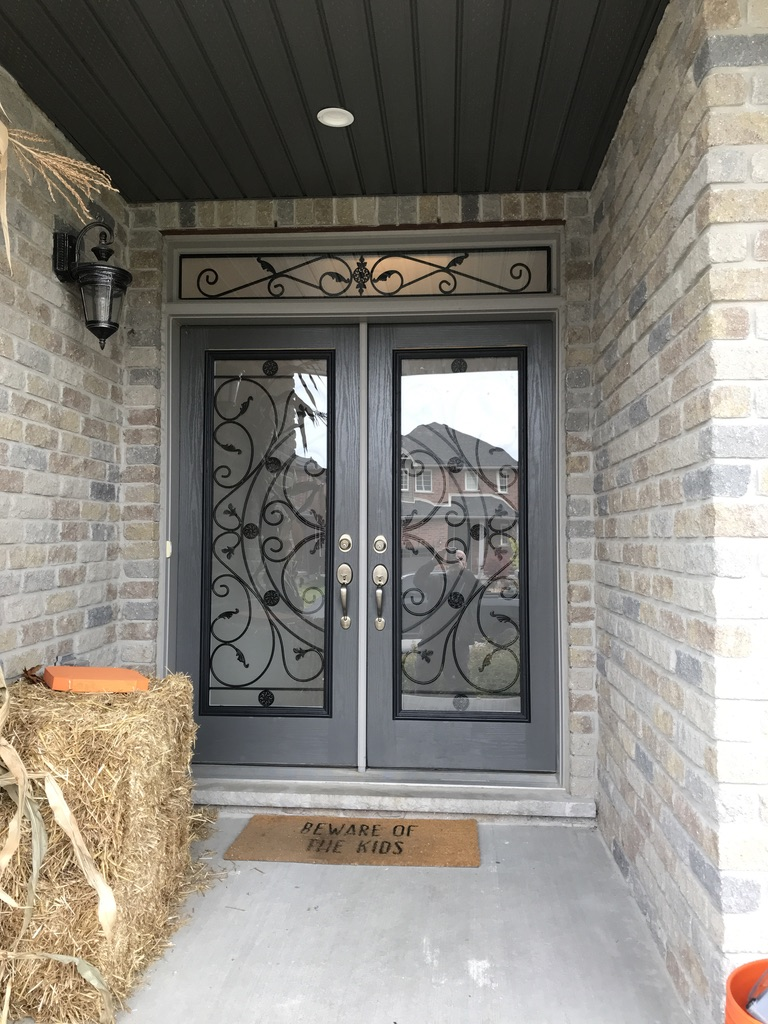 Campbellsford Wrought Iron Glass Door Inserts With Matching Transom.  Over 50 Designs of Wrought Iron and Decorative Glass Door Inserts To Choose From.