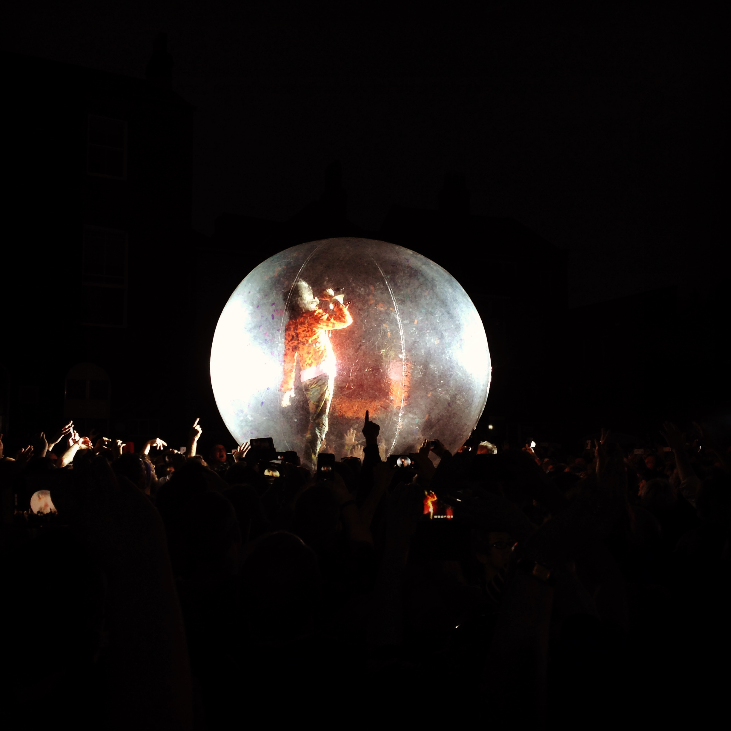 """""""For here I am sitting in a tin can"""" - channeling Bowie in a giant ball on top of the crowd."""