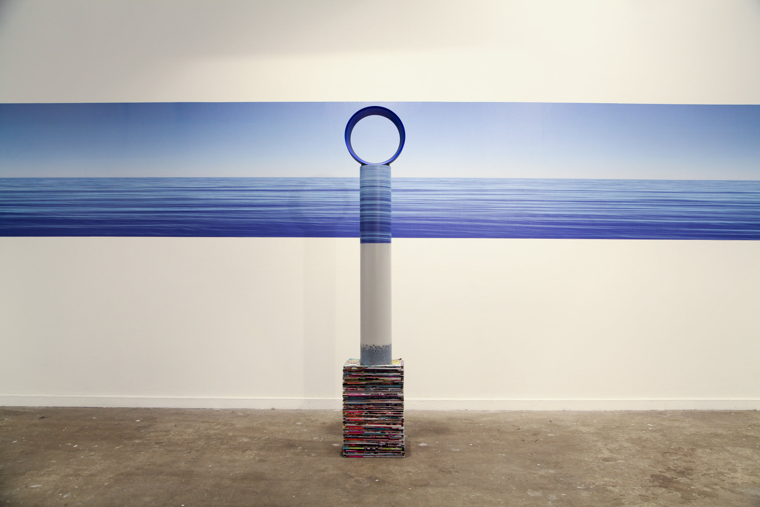 Earth, Water, Air  (foreground) and Horizon  (background), 2013, tabloid magazines (artist's personal collection), PVC pip, printed adhesive vinyl, Dyson Air Multiplier, installation view, MOP Projects, Sydney. Photography: Michael Randall. Copyright JD Reforma