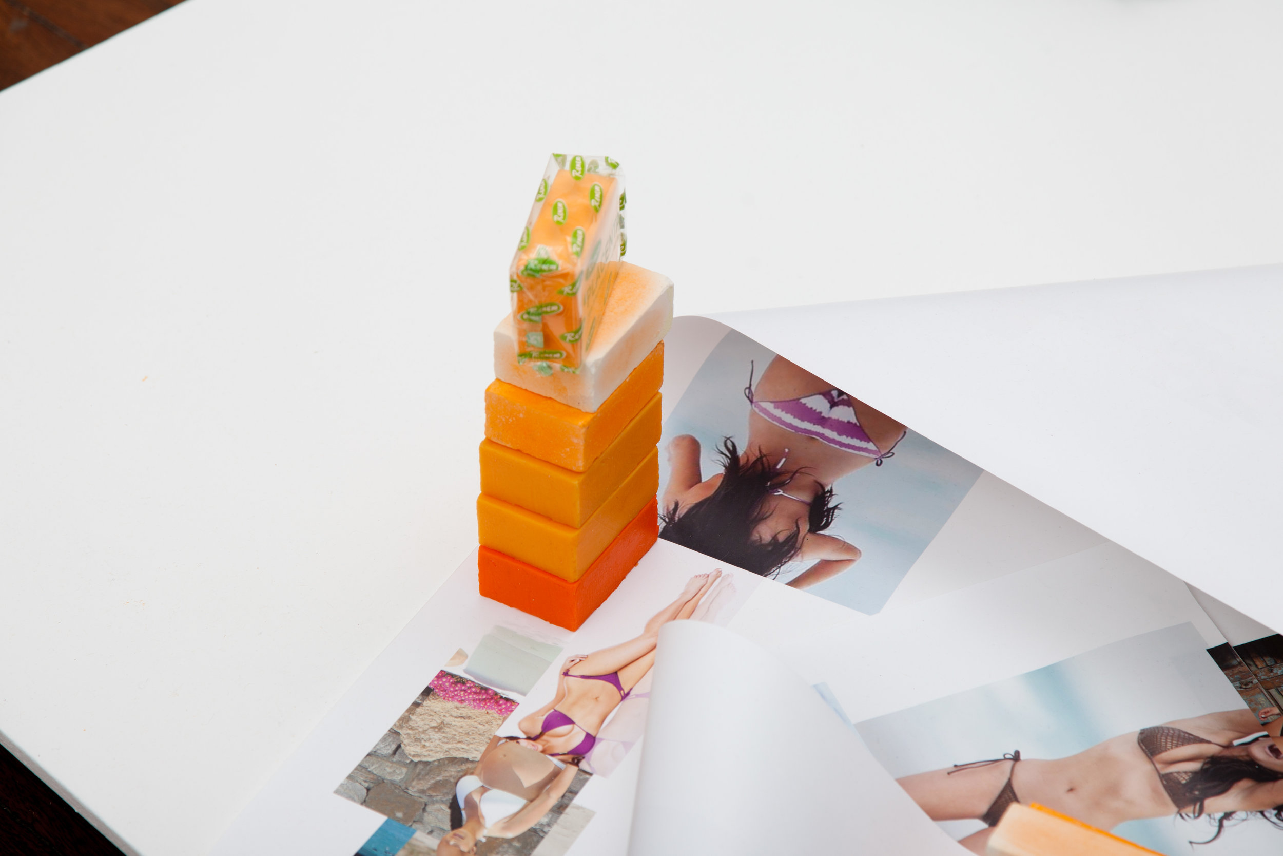 Sunset , 2012, polyurethane expanding foam, pigmented silicone, skin-whitening soap; and  Body for days , 2013, found images of Kim Kardashian, repurposed Barbara Kruger text, installation view, Life & Style , 2015, Kudos Gallery, Sydney. Photography: Brett East. Copyright JD Reforma