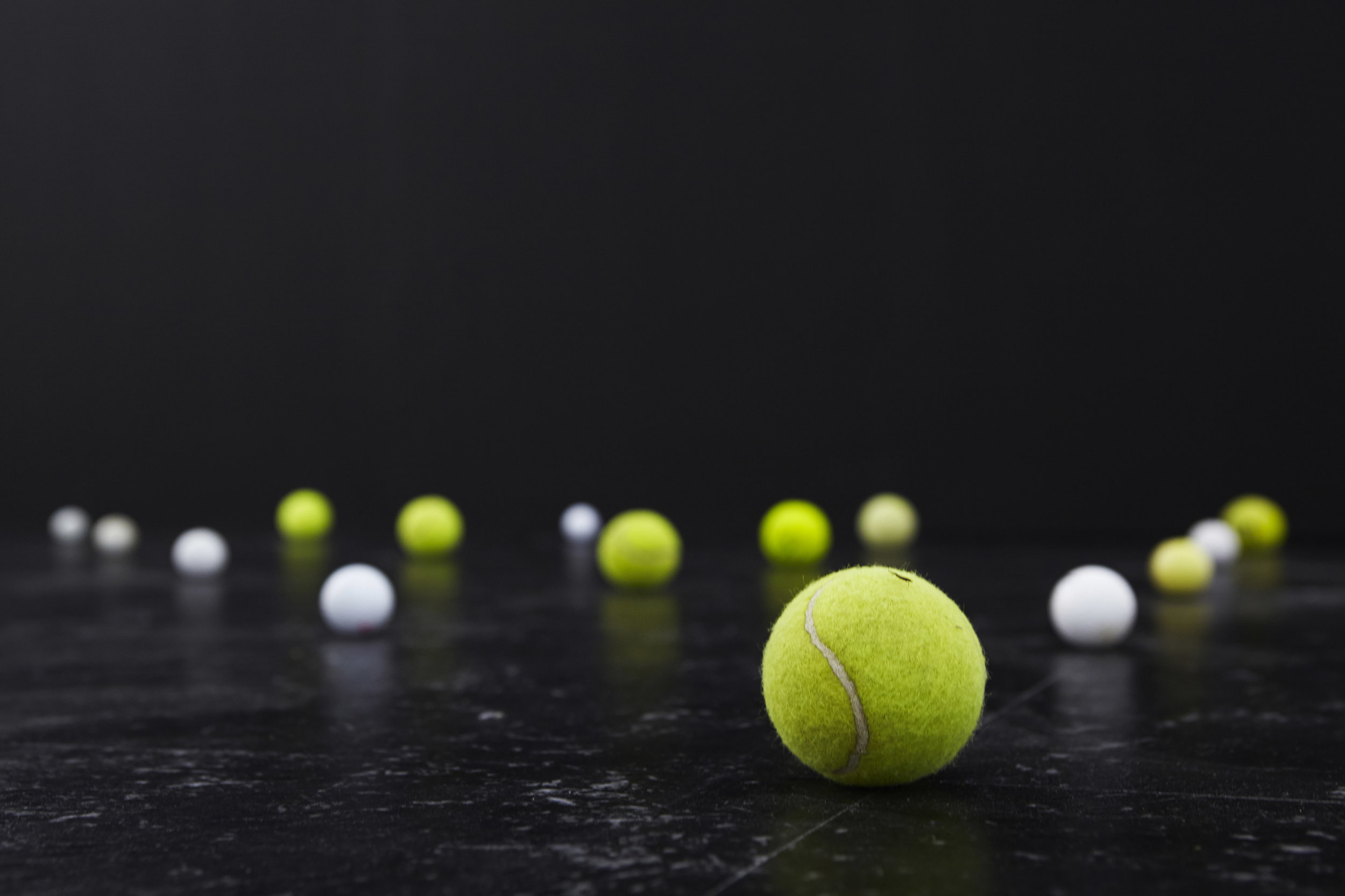 Orbit  , 2014, installation of found golf balls and tennis balls, vinyl floor tiles, paint, installation view,   THE CLOSED DOOR / THE OPEN DOOR   (with Justin Balmain), 2014, Alaska Projects, Sydney. Photo: Zan Wimberley. Copyright JD Reforma