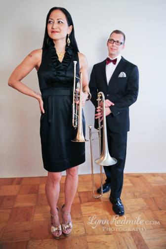 Kiku & her talented husband,  jazz trombonist David Gibson , at work with their respective musical instruments. Photo: Lynn Redmile