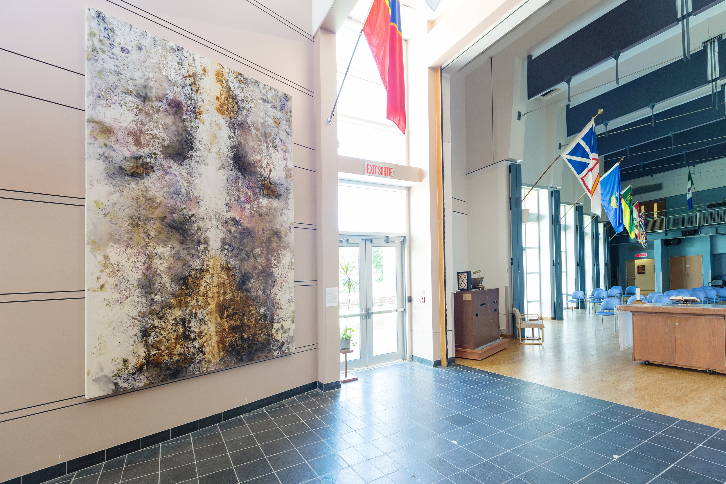 Installation View: Lupton Hall,  Perley and Rideau Veterans' Health Centre , Ottawa, On  Untitled, Various Plant Materials (including Black Walnut, Madder Root, Onion Skins, Roses, Sumac, and Wildflowers) and Rust Sediments on Canvas, 14 x 8 ft, 2019  This artwork was made by residents of the Perley and Rideau Veterans' Health Centre under the guidance of Creative Arts Instructor Gillian King and Spiritual Health Practitioner Jessie Stephenson, in collaboration with Therapeutic Recreation Creative Arts - Horticultural Services and Support Services.