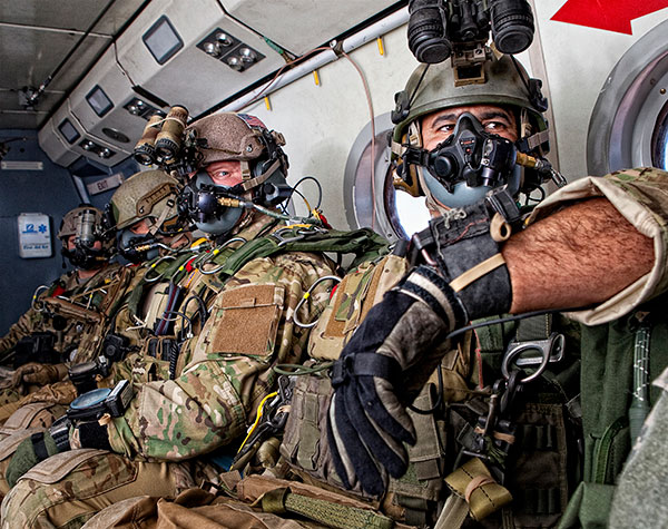 wearing oxygen apparatus and with night vision goggles mounted on their helmets, prepare to conduct a high-altitude freefall parachute jump. These Green Berets are students on the Military Free-Fall Advanced Tactical Infiltration Course (ATIC), an advanced skills training program run by the JFK Special Warfare Center and School at Yuma Proving Ground, Arizona. Recent military free-fall combat drops by special operations forces in Afghanistan and Iraq highlighted the need for a dedicated Advanced Tactical Infiltration Course.    The Military Free-Fall Advanced Tactical Infiltration Course is a 3-week course that focuses on High Altitude High Opening (HAHO) techniques. The course covers computer-guided and compass-driven navigation, night-vision rigging and emergency procedures, rigging of nonstandard combat equipment and weapons, grouping and canopy flight into unmarked or blacked-out drop zones, and the rigging, loading and deployment of GPS-guided bundles. Students will plan and execute several nighttime, oxygen HAHO operations, from 25,000 feet, using night-vision goggles in complete blackout conditions and navigating onto unfamiliar or unmarked drop zones.