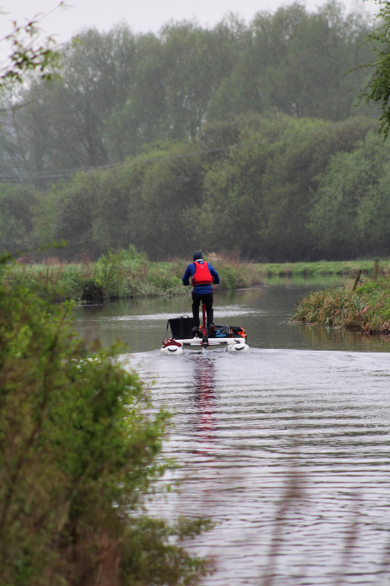 Ed Gwynne takes on the River Stort on Day One of the Waterbike Collective. Image by Tanya Noble