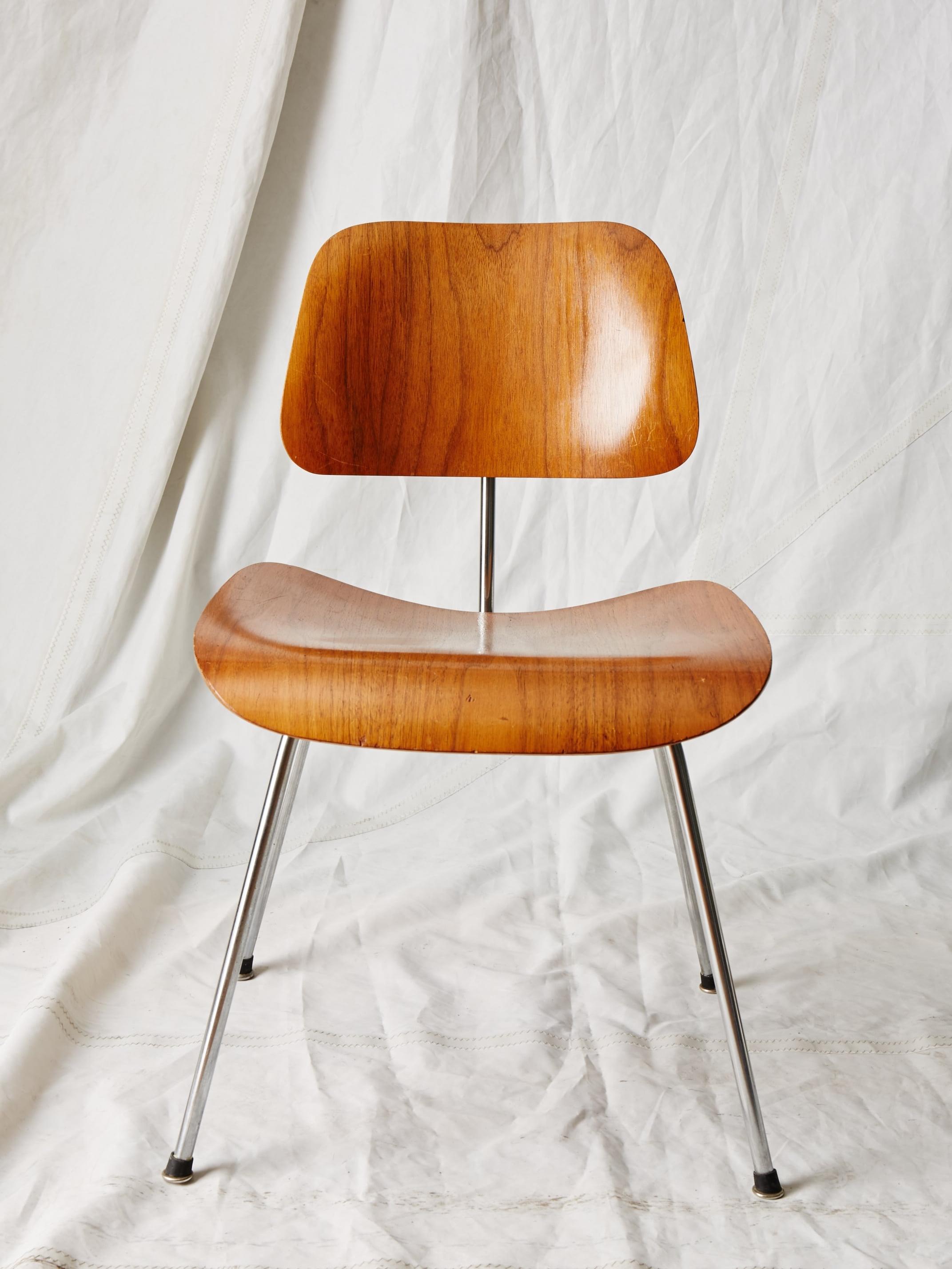 "CH003  Vintage Eames DCM 31"" H x 20"" W x 20"" D  $200/week"