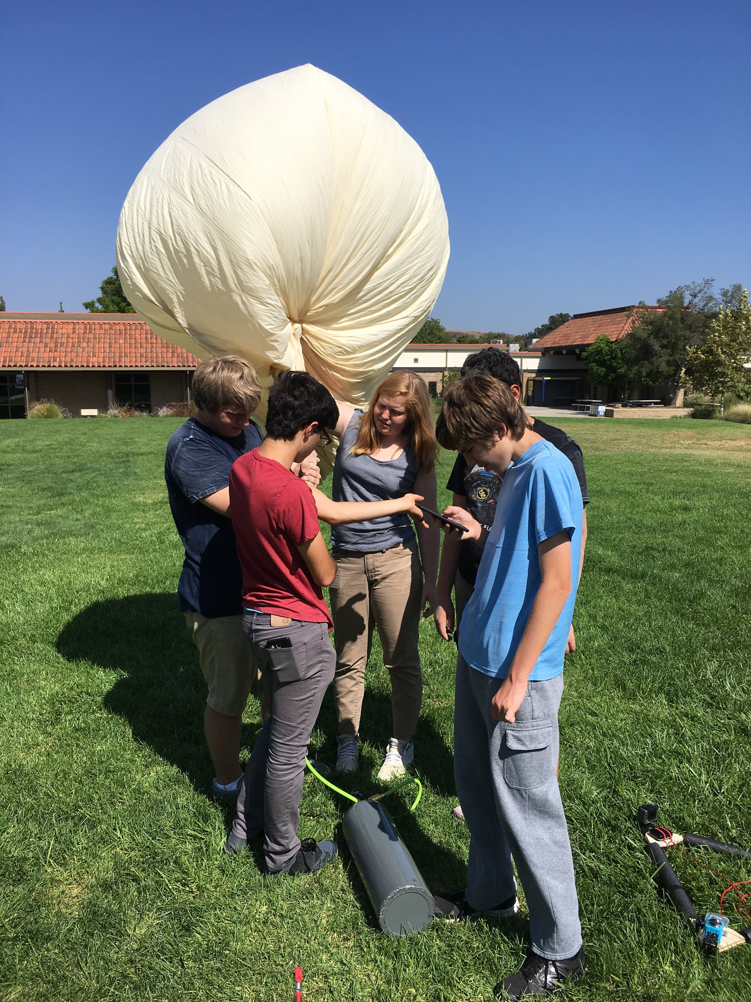 Preparing for our Launch - Before we could launch our balloon, we had to first construct our payload and learn how to operate its various electronic components. We also had to learn the procedures behind weather balloon operation. For example, we had to file a