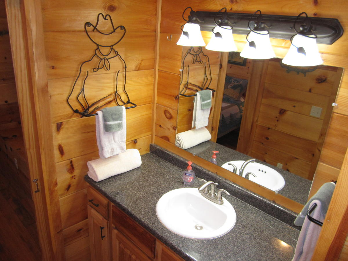 Cowboy art in Arabian Nights bathroom.