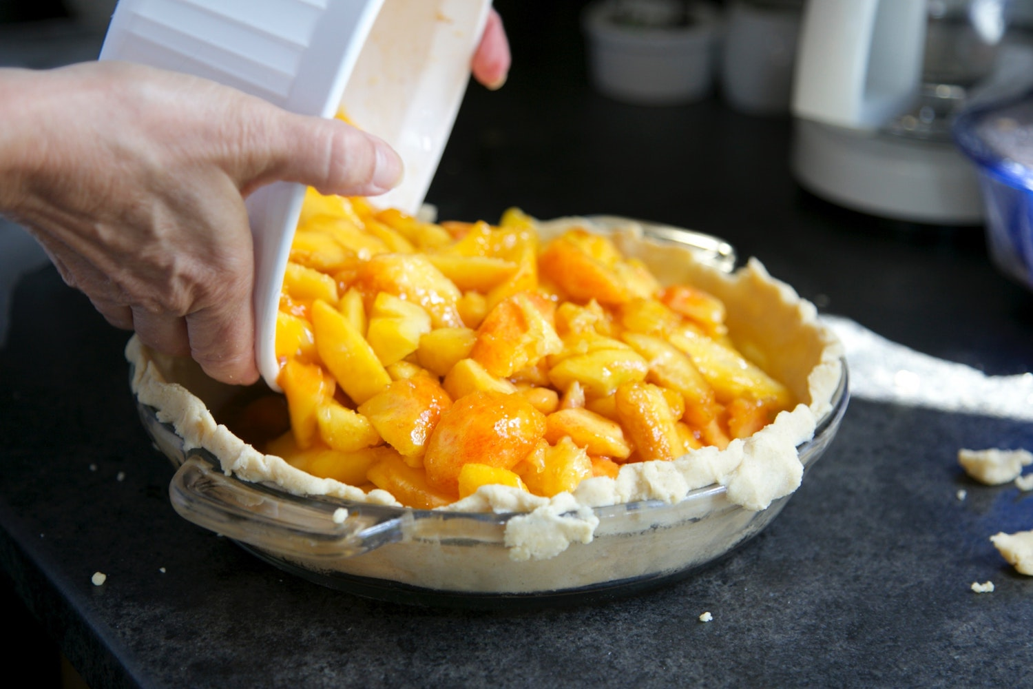 making a peach pie while on vacation