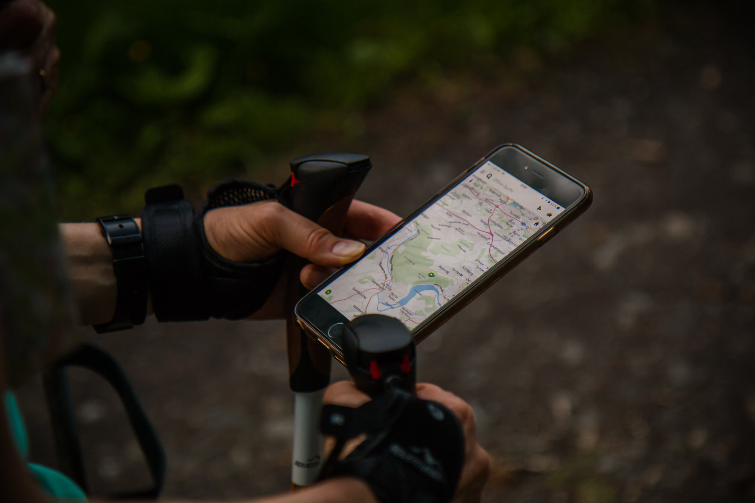 looking at a hiking map on smartphone while hiking