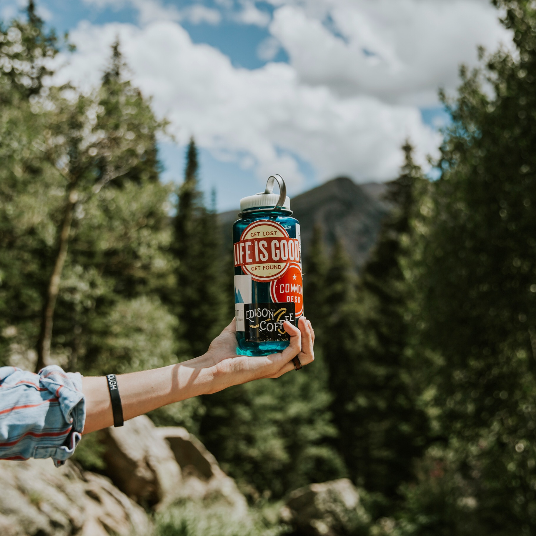 reusable water bottle used for hydrating while hiking