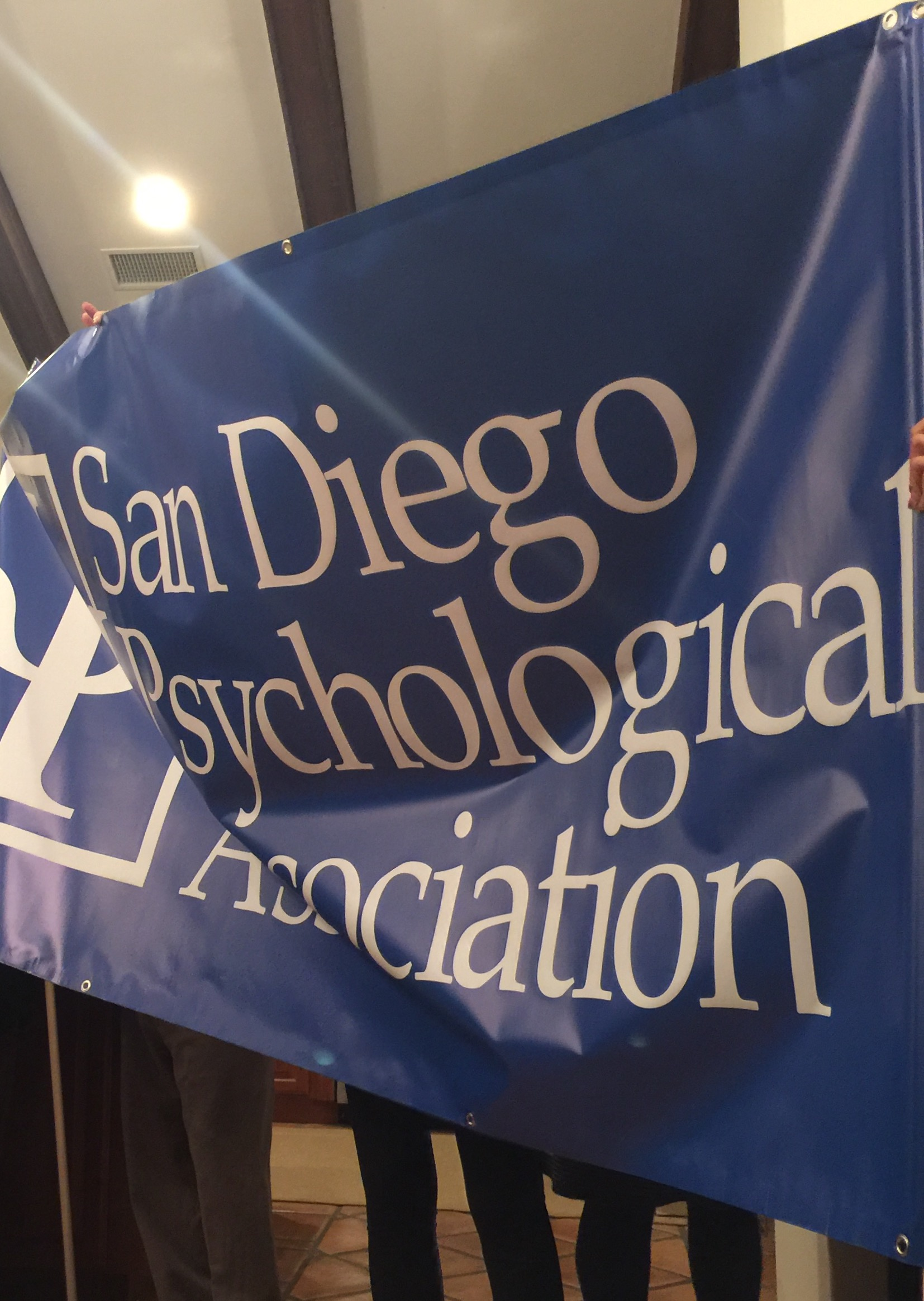 San Diego Psych Association's Banner. Held up by Board of Psych members.