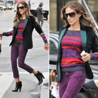 Sarah Jessica Parker goes bright and bold pairing her boots with purple cropped jeans via Fabsugar