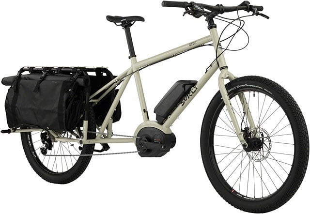#surlybikes Big Easy Cargo ebike Tan Cargo ShortsMSRP $4999  The Big Easy is a longtail electric cargo bike that expands what's possible by bike. With passenger deck seating, Surly trailer integration and the option to run dual batteries, families with children, entrepreneurs with bike supported businesses and commuters who want torunmore errands en route to their destination will appreciate the maximum cargo potential of Big Easy.  Condensed bike size range and dropper post routing to promote bike sharing and to accommodate more riders per frame size  Fully tested and rated electric bike component set  Capable of running dual batteries for extended range  Damping headset provides smooth and stable handling characteristics under heavy loads  Equipped with the most powerful Bosch electric bike motor and largest battery available  Includes Bosch Standard 4A charger, wiring harness and brackets for additional battery  Bosch Performance Line CX Drive:  Provides a maximum torque of 75 Nm, with assistance up to 20 mph. No overheating, even during long ascents  Up to 300% of perfectly delivered support, incredible dynamism and unique grip provide the best possible support on all terrains  The progressive motor support automatically adapts to the individual's riding style, so there is no need to change support modes in eMTB mode  Ideal drive system for ambitious and demanding eBikers  PowerPack 500 Battery:  Increased capacity to 13.4 Ah (Amp-Hours), with 500 Wh (Watt-Hours) for extended range  36-volt Lithium-ion battery requires about two hours to charge 50%, and full charge takes approx. 4.5 hours with the Bosch Standard Charger  Frame-mounted battery pack weighs 5.7 lbs  Bosch Standard 4A Charger included  Expand what's possible with Dual Battery Operation:  Big Easy is designed and configured to easily accommodate a second battery; an ideal solution for cargo bike applications  Dual Batteries deliver up to 1,000 Wh for even more range and capability  The Bosch DualBatt