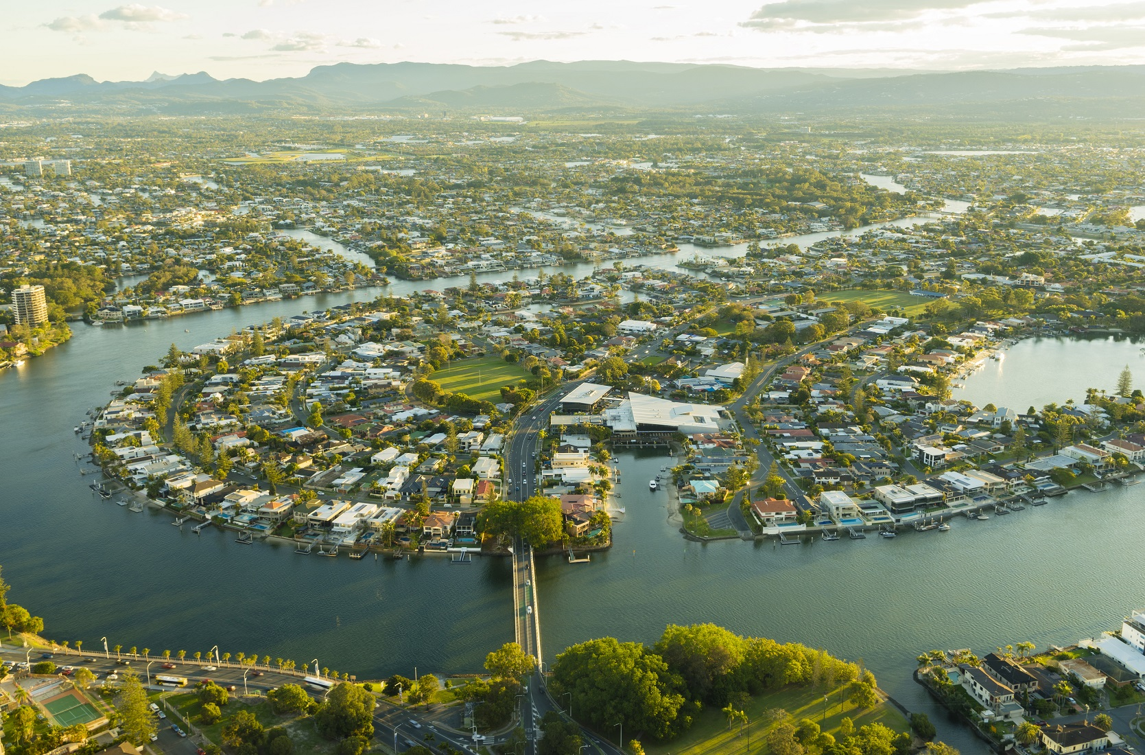 Looking south over the Nerang River into Bundall, Broadbeach Waters. Clear Island Waters. The many rivers and creeks on the Gold Coast have allowed for extensive canals, providing relatively affordable waterfront property for a city of its size.