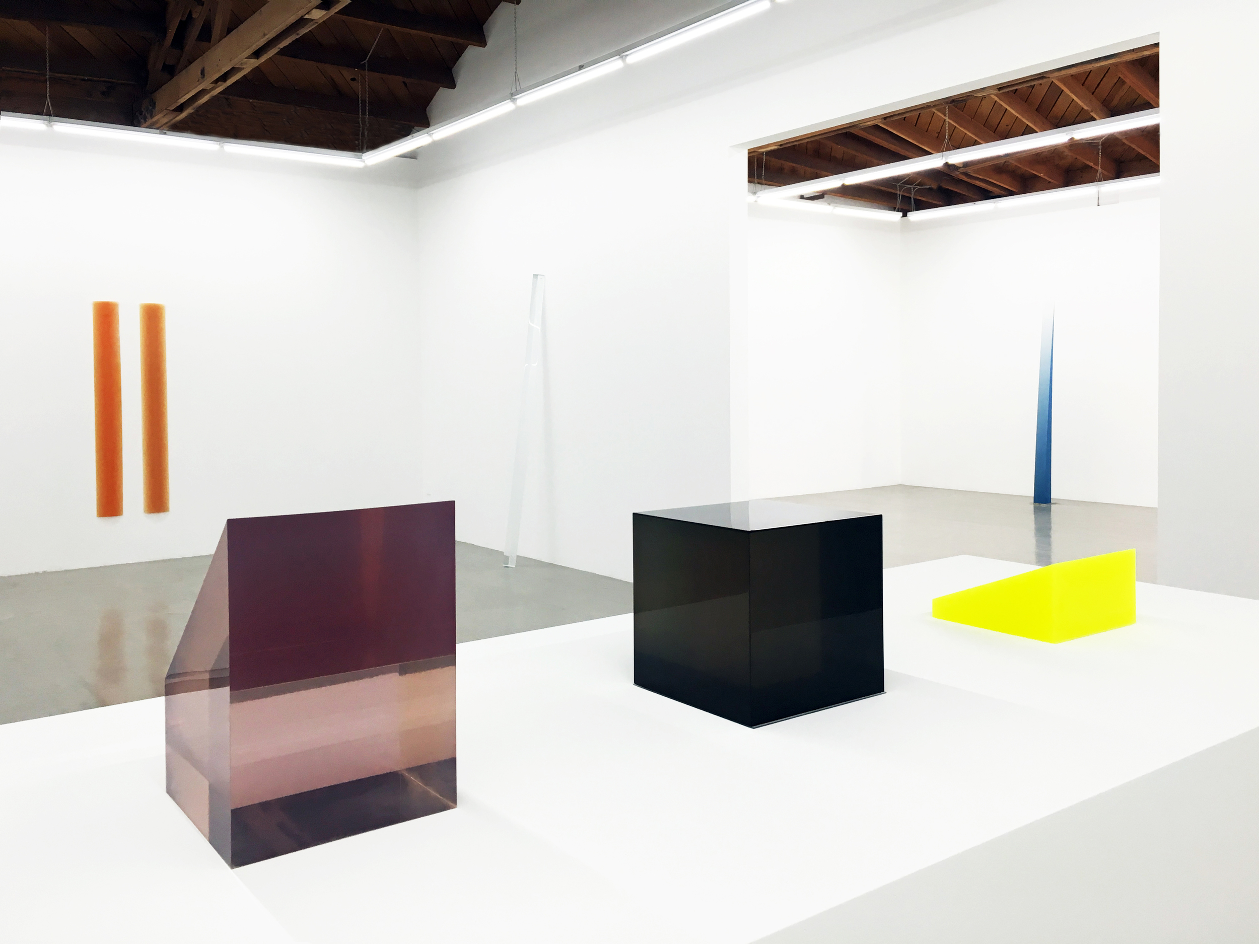 Installation view of Peter Alexander's various colored resin sculptures