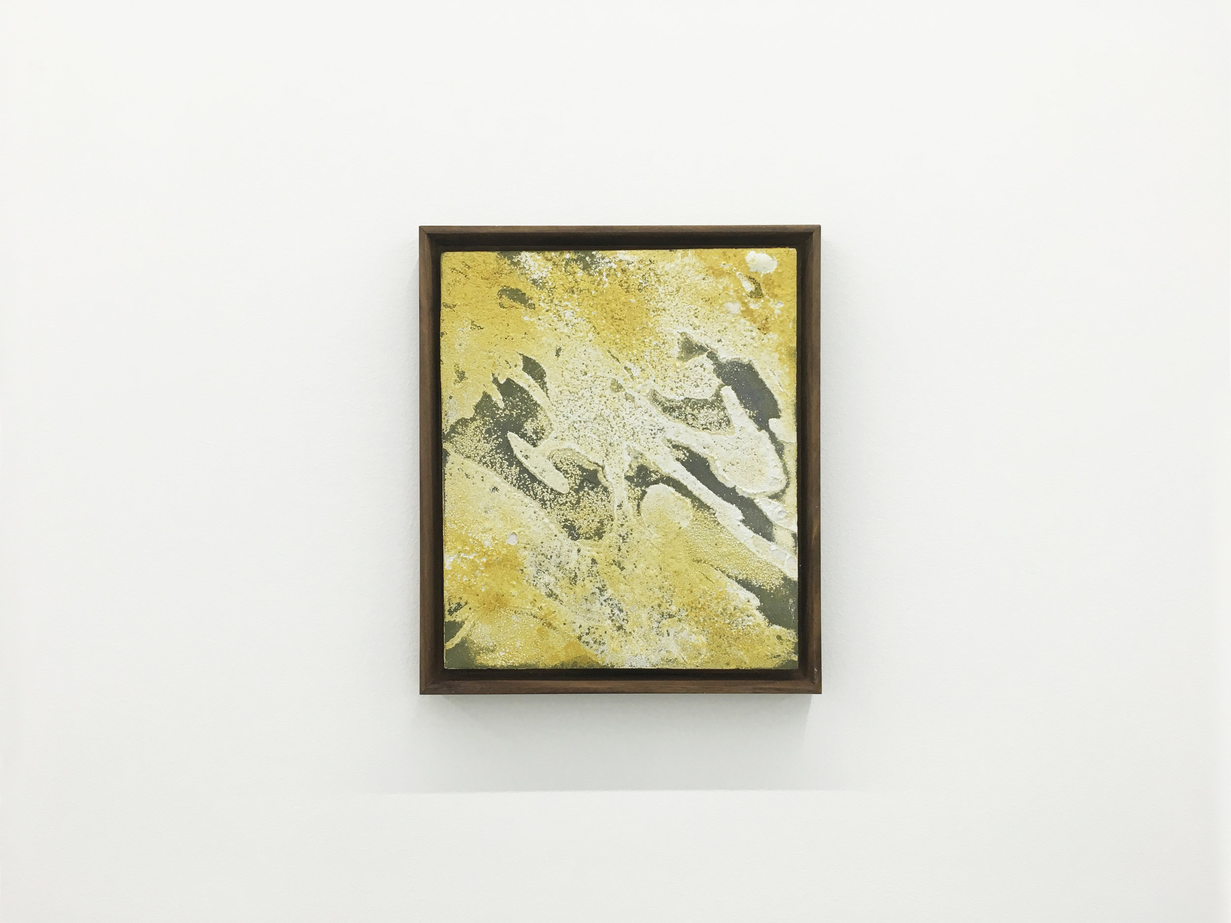 Small abstract painting made with bee pollen in a floating dark walnut frame