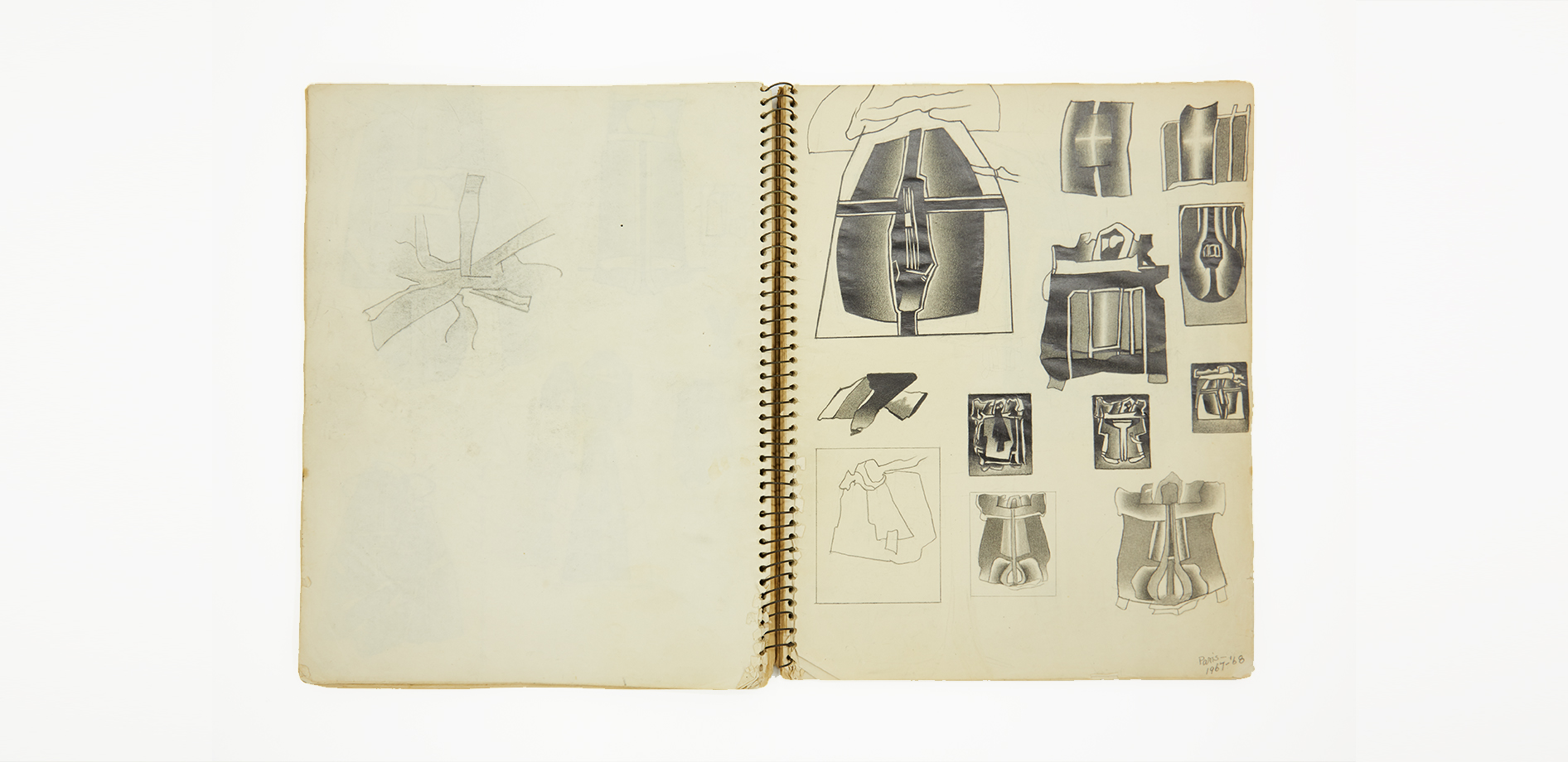 View of a page in Deborah Remington's sketchbook. Multiple small sketches of shield like shapes