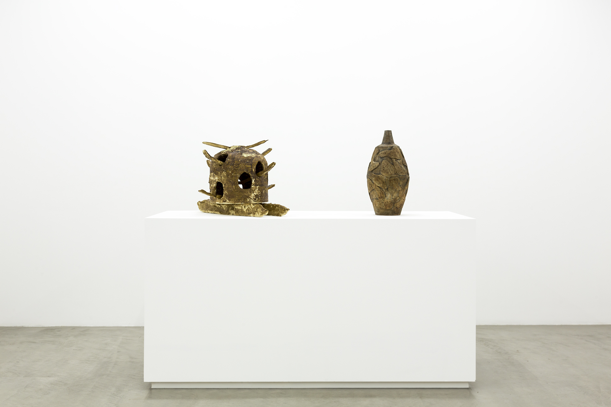 Installation view of Jesse Wine and Peter Voulkos works in abstract ceramic forms.