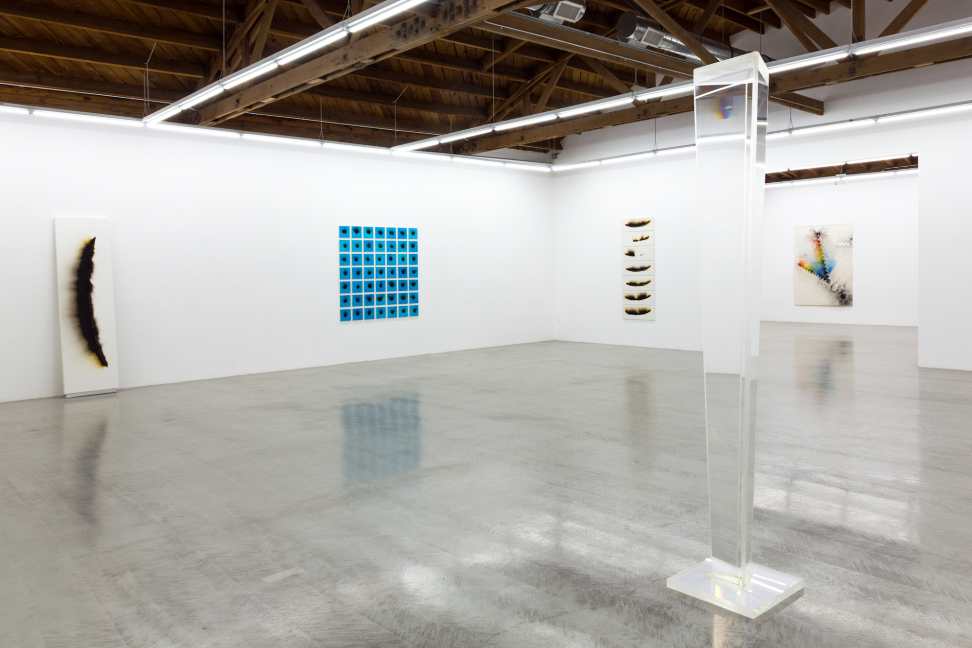 Installation view of Charles Ross' Solar Burns, Explosion Drawings and Prisms.