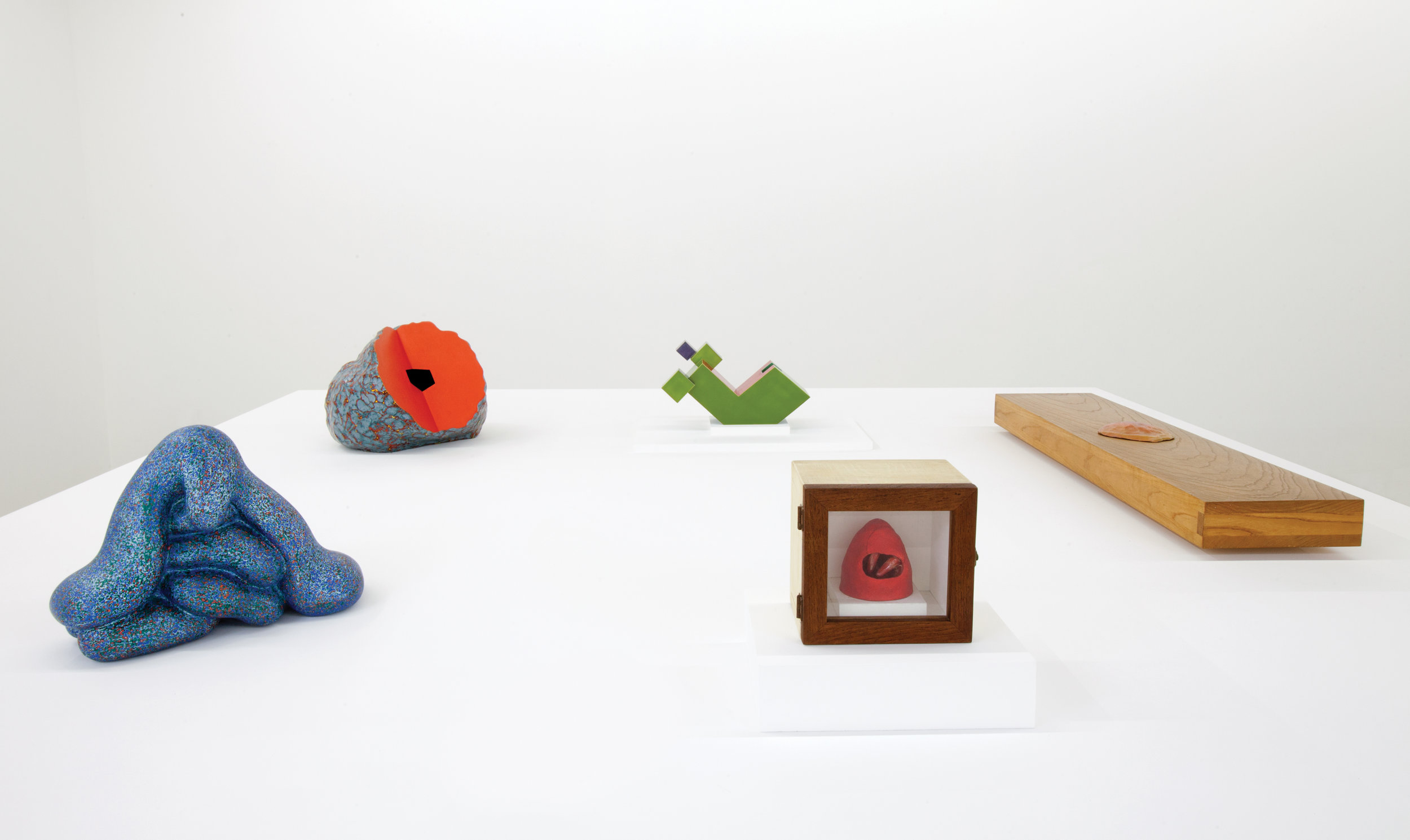 """View of """"Ken Price,"""" 2016.  From left:  The Slouch , 2005;  Rebuncular , 1988;  Untitled (Geometric) , 1980;  Untitled (Red Mound) , 1960–61;  Untitled , 1967–69."""