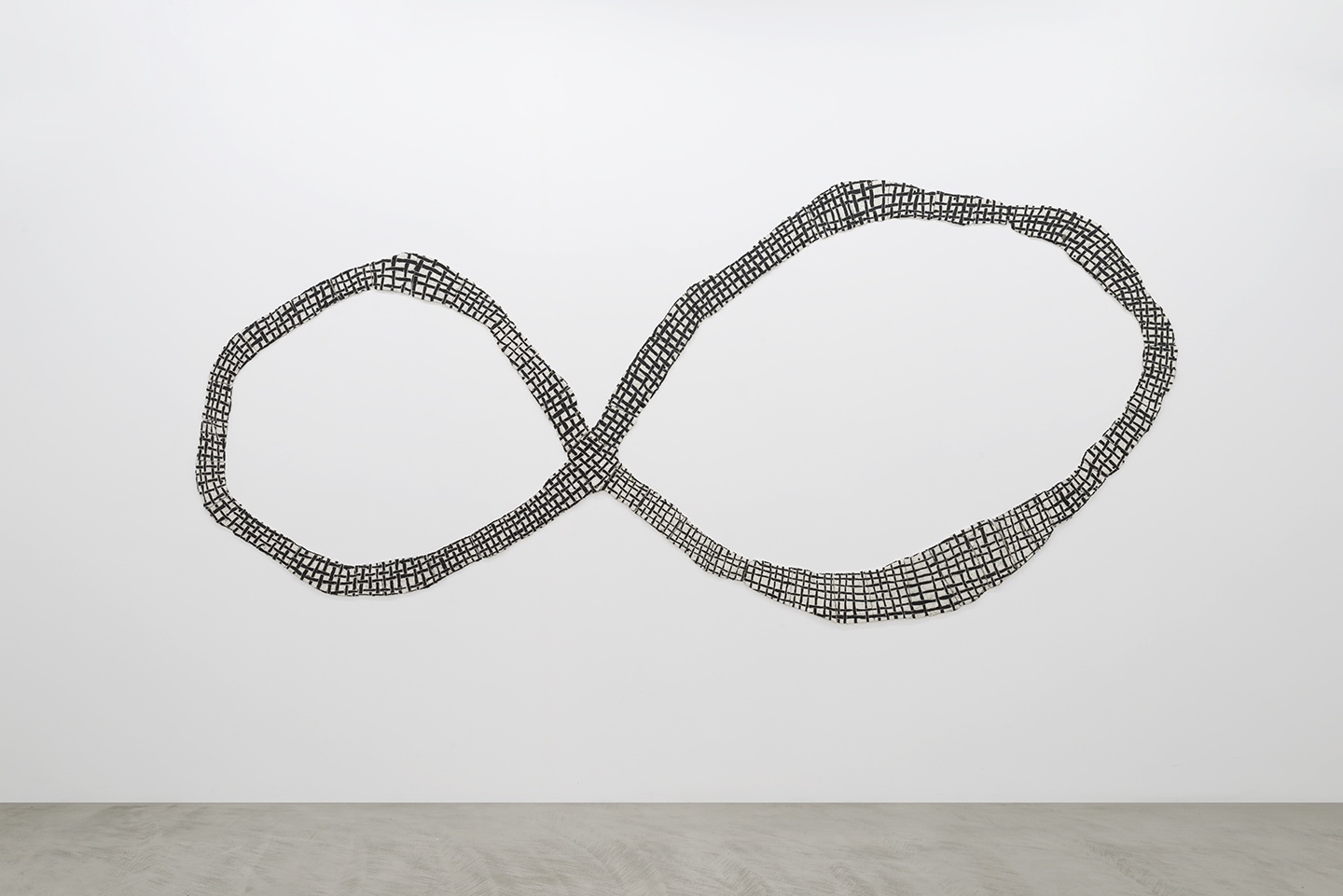 Julia Haft-Candell's Wall Infinity: Weave a large almost two-dimensional porcelain wall piece with black underglaze to create a criss-crossed effect