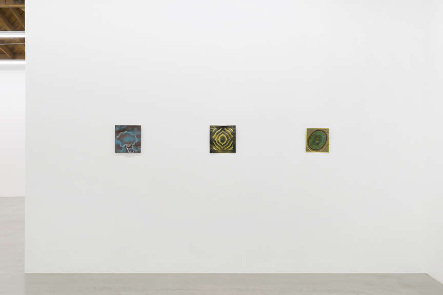 Installation view of three small works from Billy Al Bengston's Dentos series