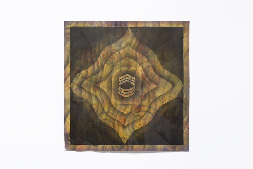 Billy Al Bengston's Fighting Kentuckian resembling a dark and golden abstract flower with chevrons and semi-circles in the interior of the aluminum panel