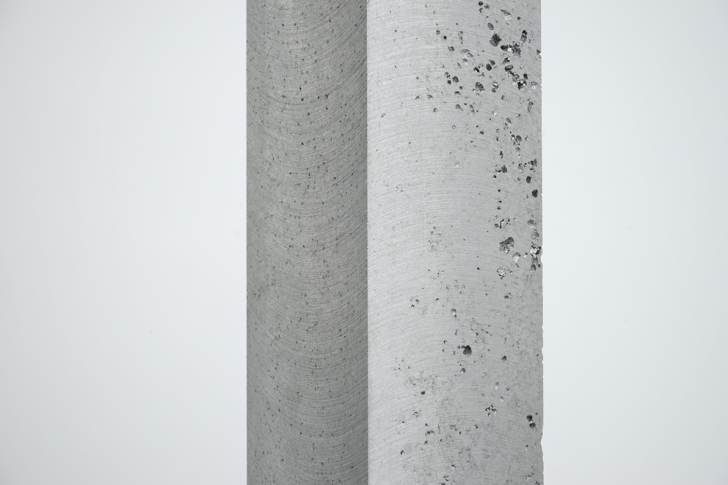 Close up image of one of Daniel Turner's aluminum and steel cast bars showing detail of the poured sculpture