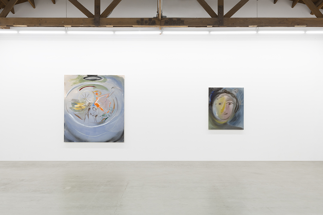 Installation view of two of Sophie von Hellermann's paintings, the first depicting a ferris wheel at the seaside, the second an abstract portrait