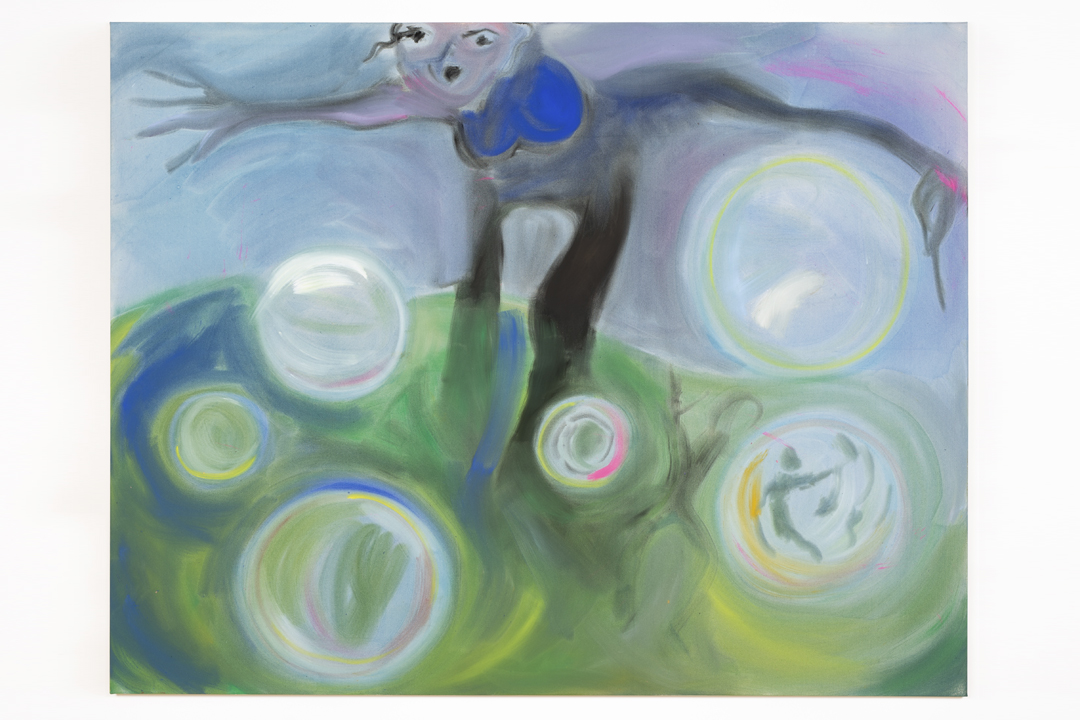 Sophie von Hellermann's flowing painting titled Bursting Bubbles depicting a large female figure on a green hill with outstretched limbs peering over floating bubbles, one with a hazy figure inside