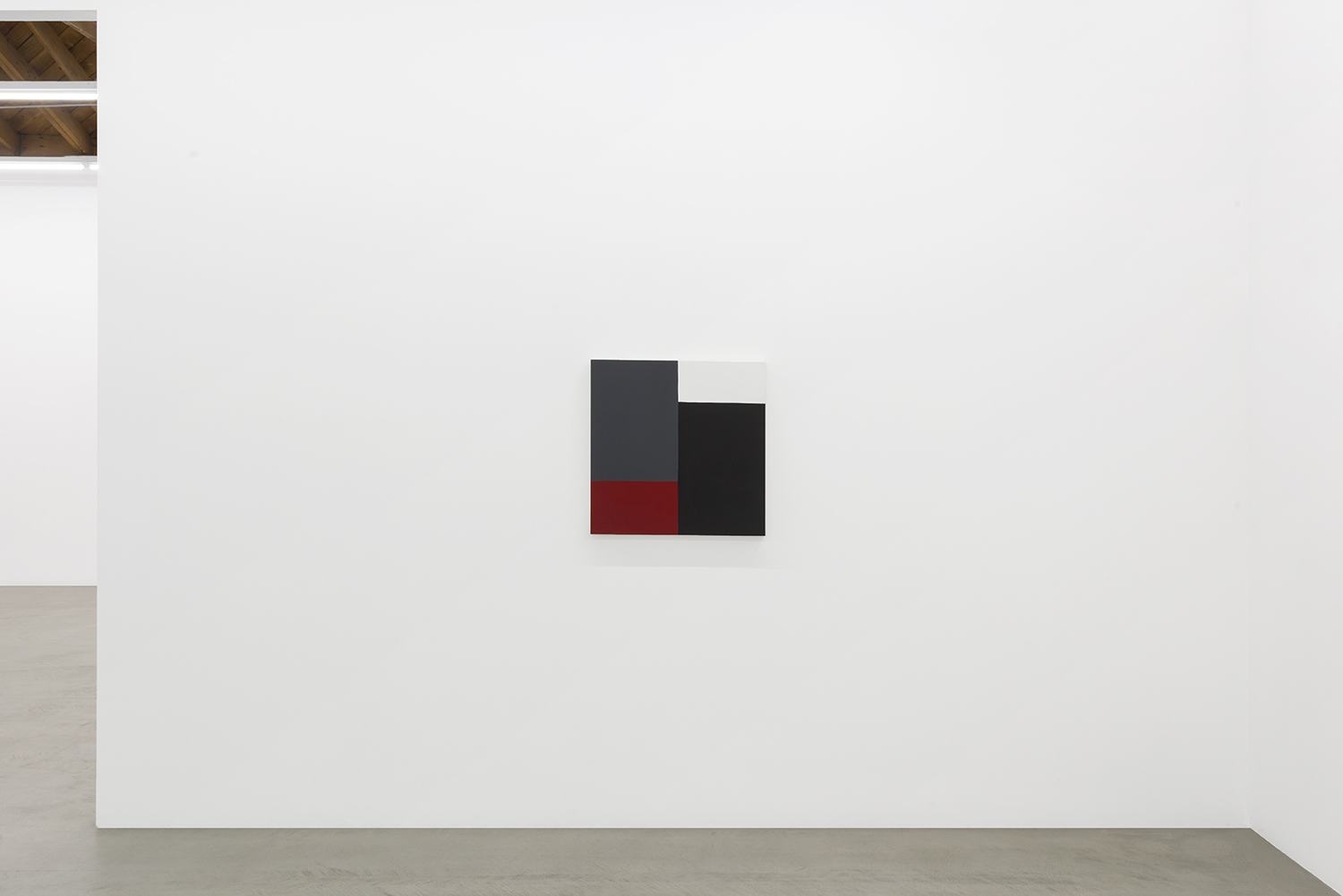 Edith Baumann's earliest paintings from 1977 showing a grid of grey, red, white and black