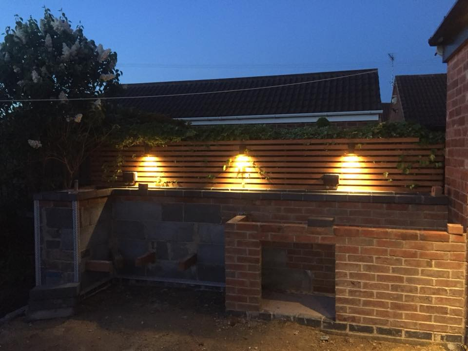 patio cladding, seating and bbq in progress.jpg