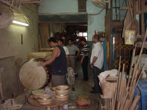 Watching the drum makers in Tainan City Taiwan. February, 2006.