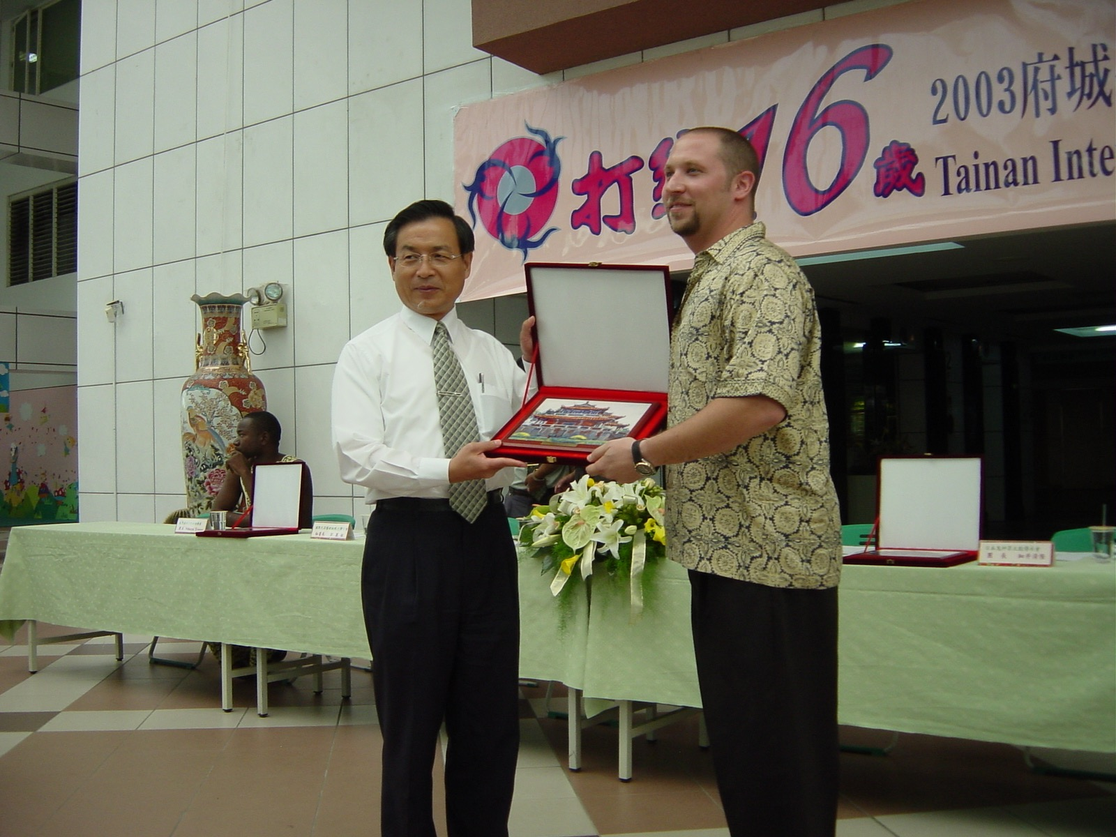 Randy receiving a gift from the Mayor of Tainan city. Taiwan, 2003