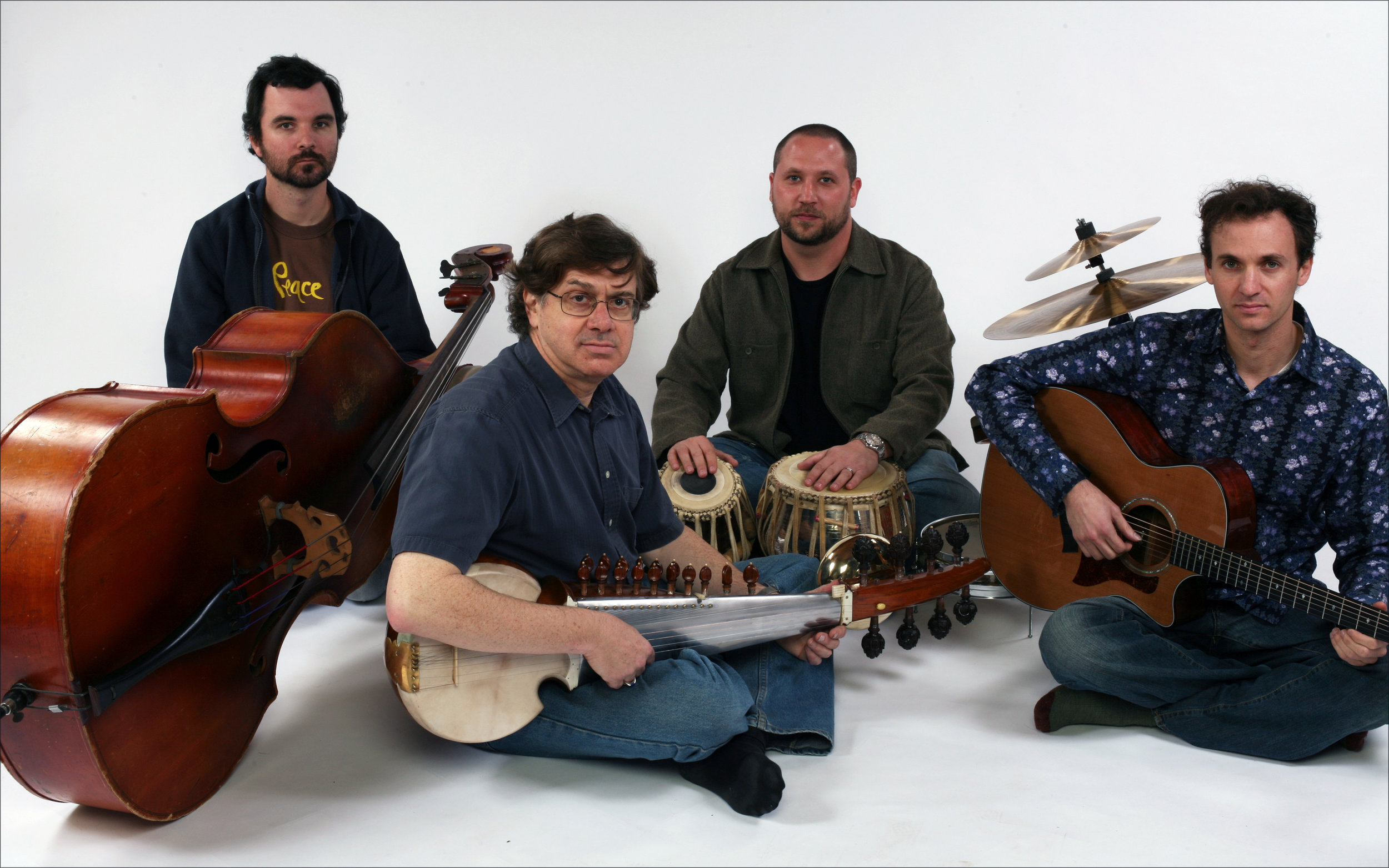 Svara: New World Music Ensemble led by Sarode player David Trasoff.  L-R: John Graves, David Trasoff, Randy Gloss, Robert Jacobson.  Photo by Jimmy Steinfeldt.