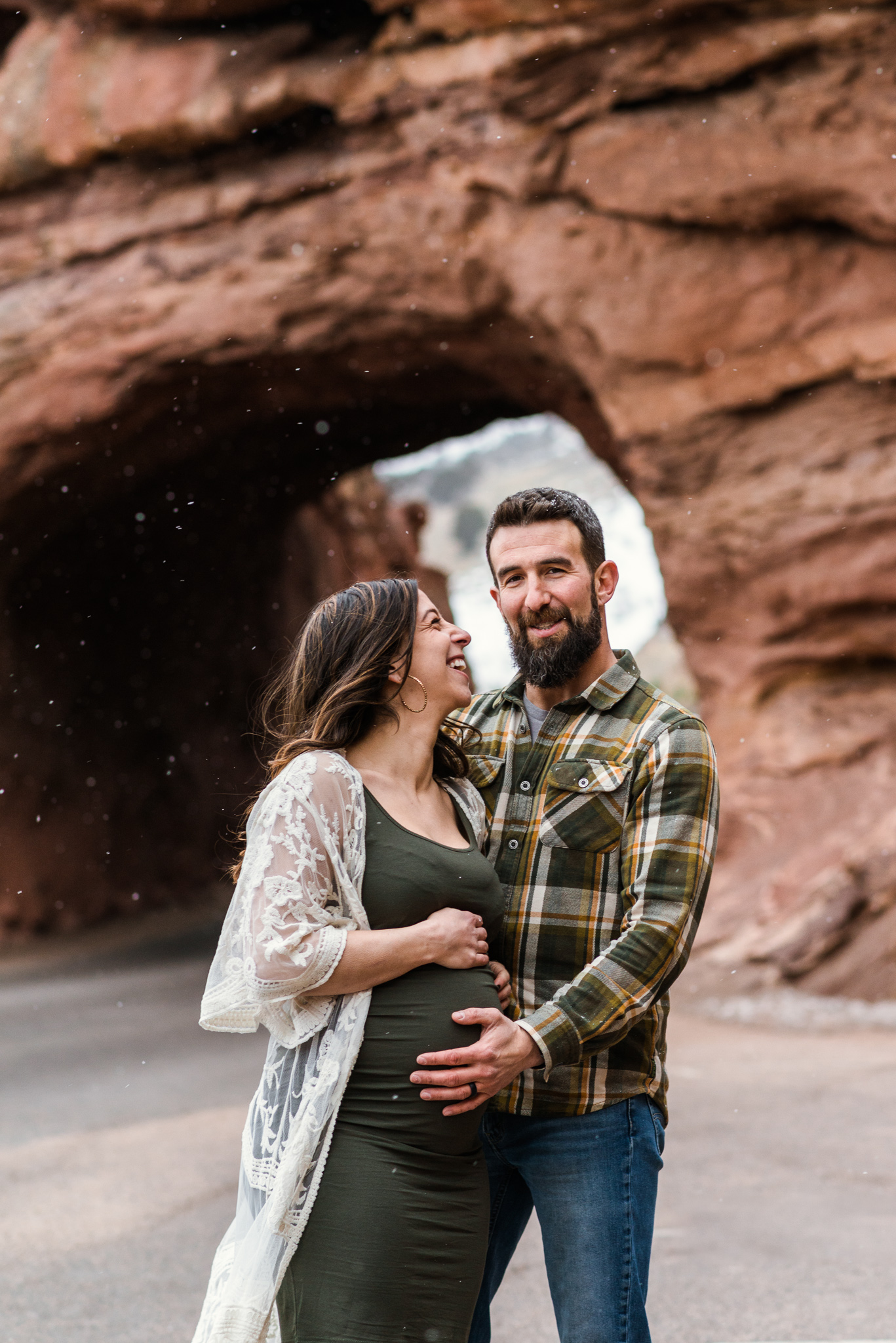 """Gabrielle took beautiful maternity pictures for us at Red Rocks! Before we got there she had scoped out the perfect location for the pictures. Even though it was freezing, she toughed it out for us and we got so many great shots. I would definitely recommend Gabrielle, she was easy to communicate with and great to work with!"""