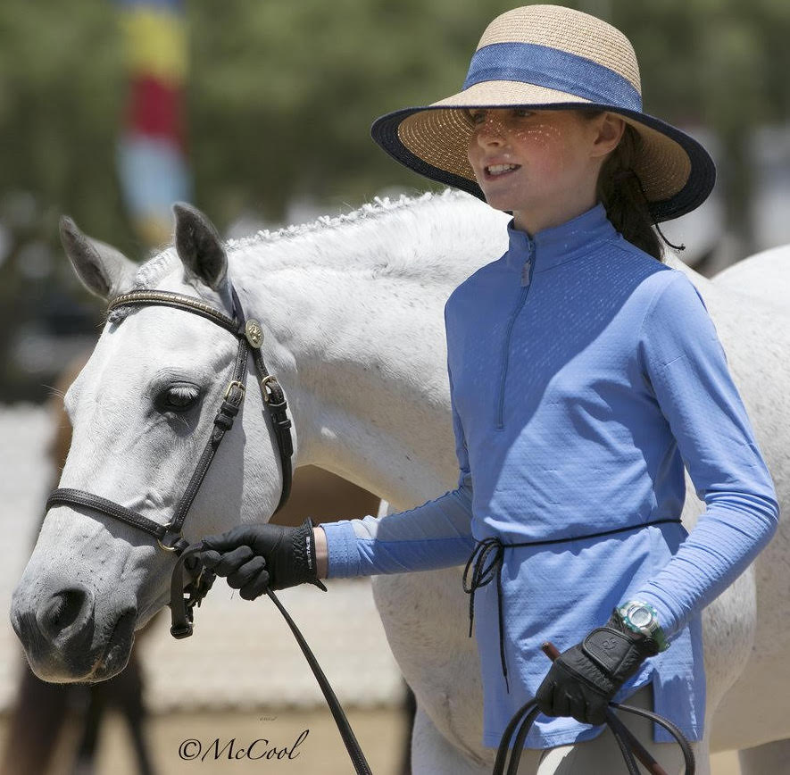 Junior Handler classes: riders wear a clean outfit in light colors, pants that contrast with their pony's color (dark pants with a light pony), gloves and hair pulled back under a hat to keep sun off the face.