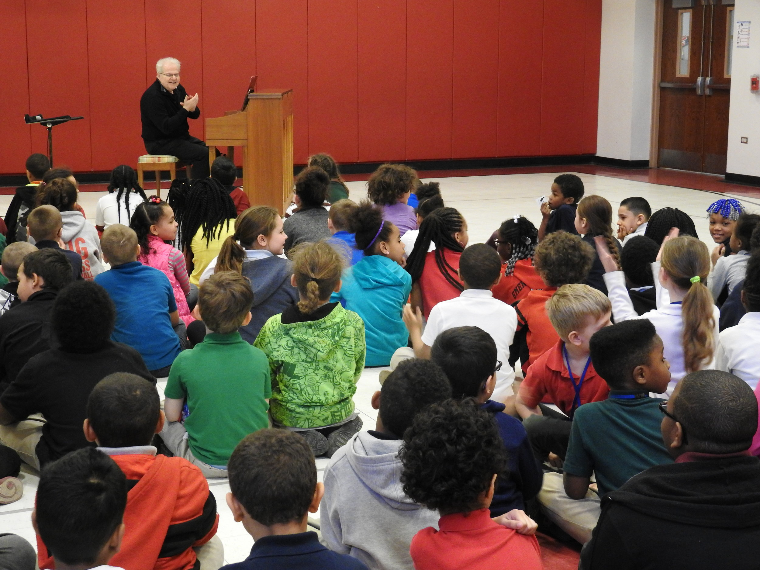 Pianist Emanuel Ax performing at the Emerson Gridley Elementary School in Erie, Pennsylvania, as a guest artist brought in by Erie Philharmonic.