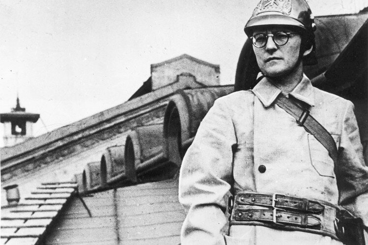 Shostakovich dressed and posed on a roof as a firefighter for after bombing raids, although he never served in the war