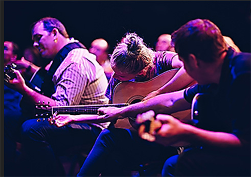 learn to play guitar team building