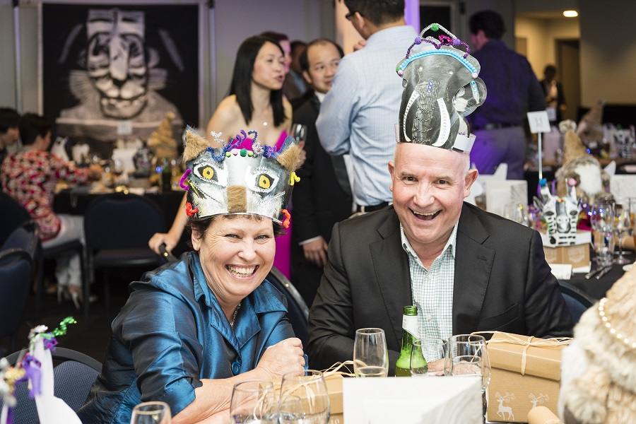 Image: Two employees of Liberty International Underwriters wear animal-inspired party hats created by the Props Collective for their Christmas party held at Taronga Zoo.