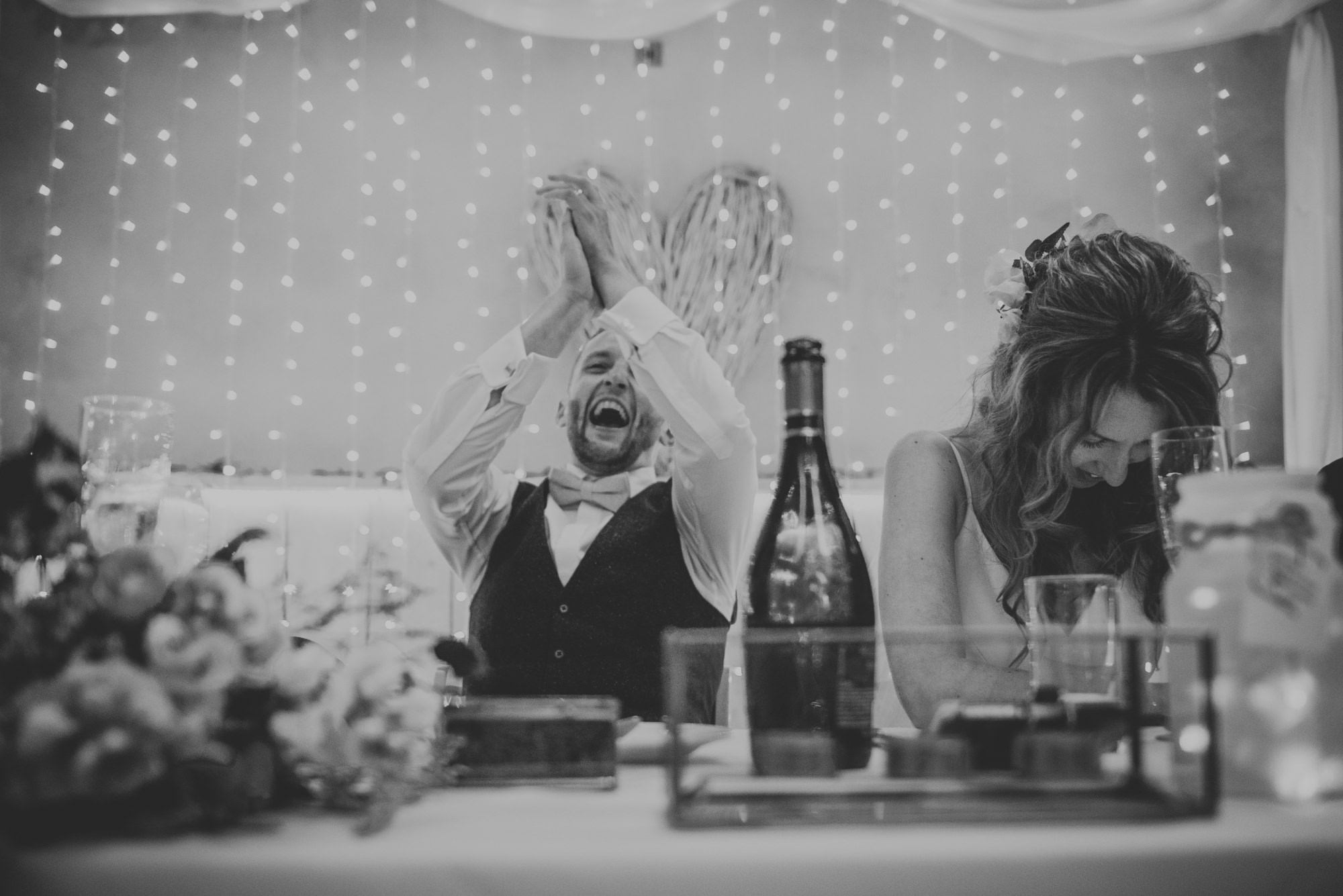 black and white wedding speeches groom laughing