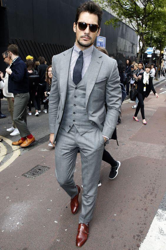 Bearded man in grey three piece suit