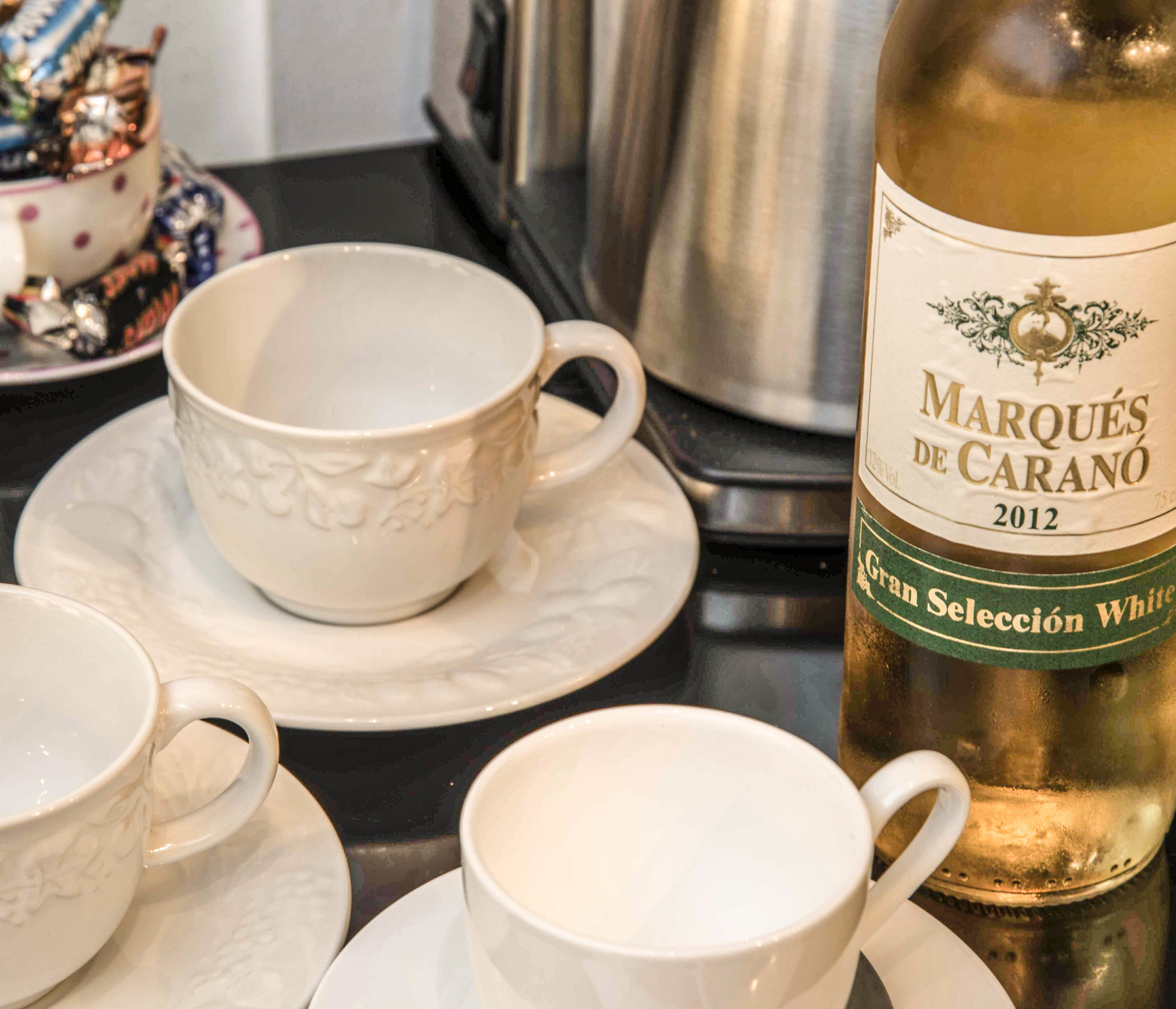 Coffee cups and a bottle of white wine.jpg