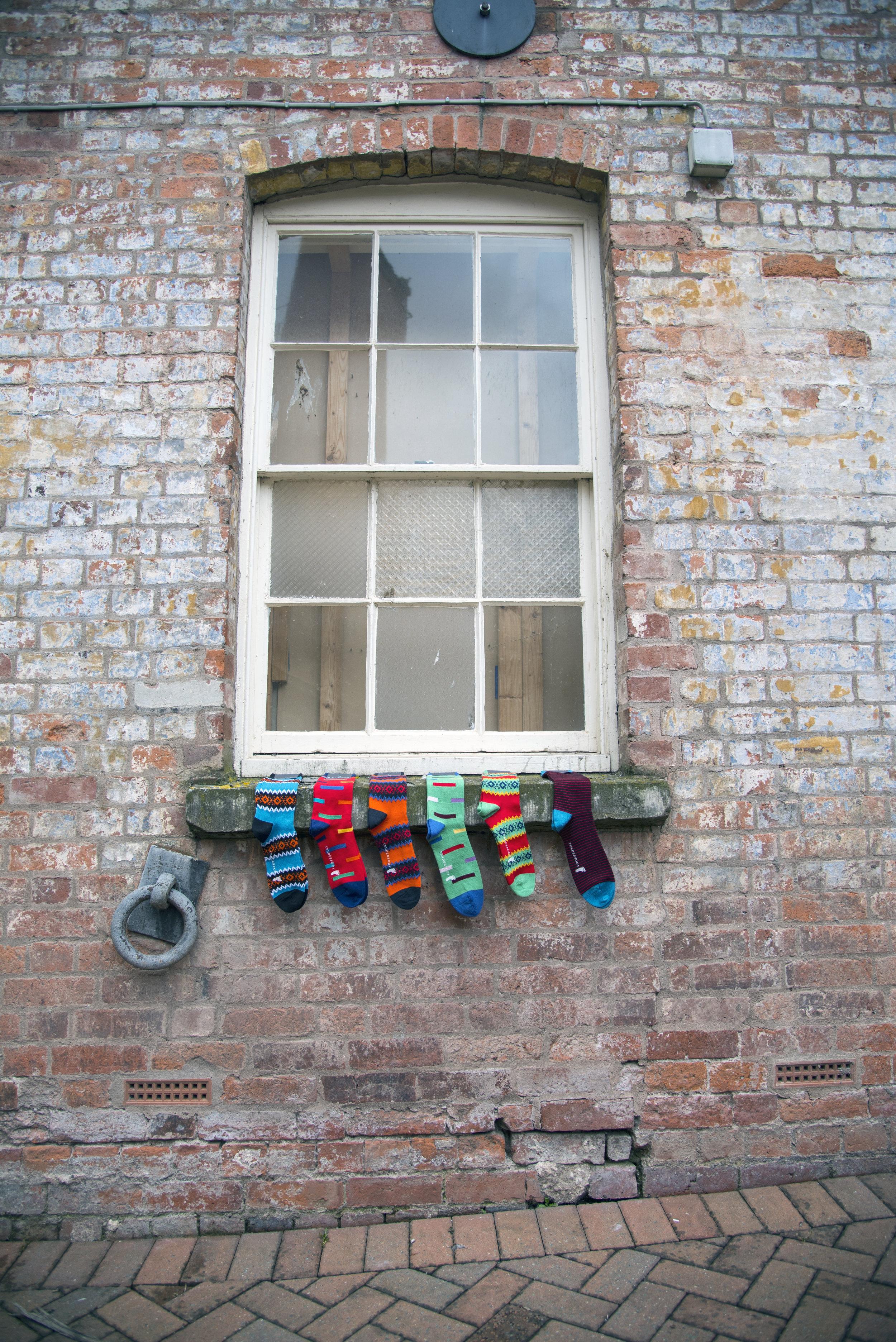 Row of socks on wall in Hereford.jpg